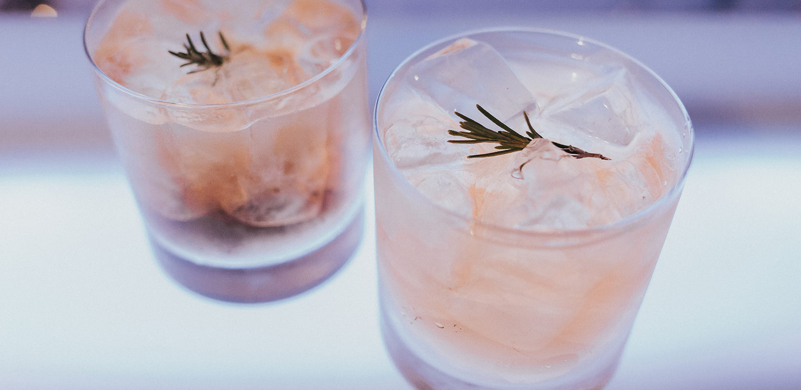 whiskey rose cocktail recipe with rosemary, lemon, and sparkling apple soda